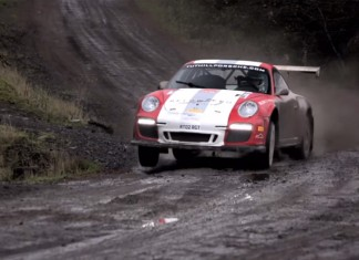 Chris Harris wrestles a Tuthill Porsche 997 R-GT on gravel